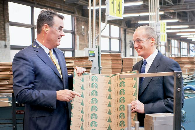 two men in factory with Starbucks' EarthSleeve