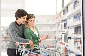 male and female consumers with shopping cart
