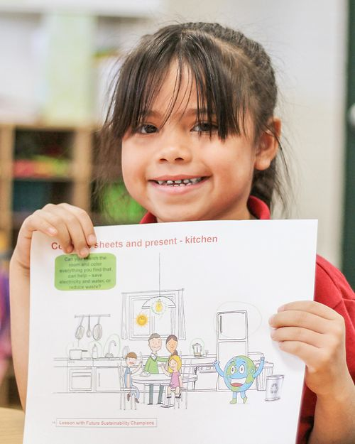 girl holding sustainability teaching materials